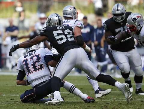 a491ec1ad New England Patriots quarterback Tom Brady (12) is sacked by Oakland  Raiders defensive end