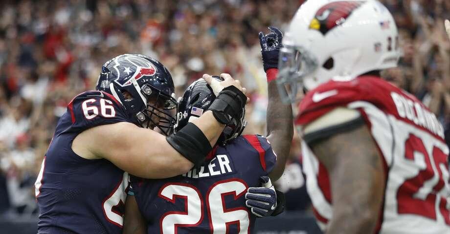 Houston Texans running back Lamar Miller (26) celebrates his touchdown with center Nick Martin (66) during the second quarter of an NFL football game at NRG Stadium,  Sunday, Nov. 19, 2017, in Houston.   ( Karen Warren / Houston Chronicle ) Photo: Karen Warren / Houston Chronicle