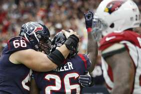 Houston Texans running back Lamar Miller (26) celebrates his touchdown with center Nick Martin (66) during the second quarter of an NFL football game at NRG Stadium,  Sunday, Nov. 19, 2017, in Houston.   ( Karen Warren / Houston Chronicle )