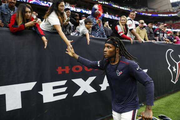 Houston Texans wide receiver DeAndre Hopkins (10) high fives fans as he leaves the field following the Texans 31-21 win over the Arizona Cardinals in an NFL game at NRG Stadium on Sunday, Nov. 19, 2017, in Houston. ( Brett Coomer / Houston Chronicle )