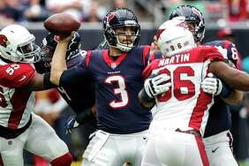 Houston Texans quarterback Tom Savage (3) throws a pass as he is pressured by Arizona Cardinals outside linebacker Chandler Jones (55) during the first quarter of an NFL football game at NRG Stadium on Sunday, Nov. 19, 2017, in Houston. ( Brett Coomer / Houston Chronicle )