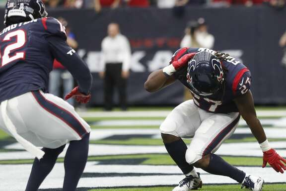 Houston Texans running back D'Onta Foreman (27) celebrates his touchdown with a dance with Bruce Ellington (12) during the fourth quarter of an NFL football game at NRG Stadium,  Sunday, Nov. 19, 2017, in Houston.   ( Karen Warren / Houston Chronicle )