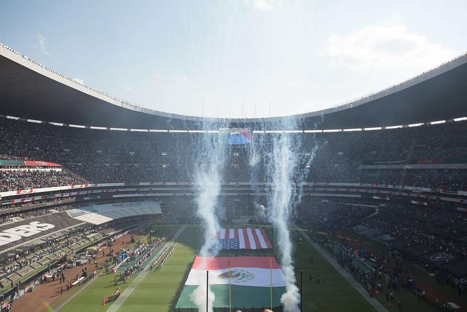 Fireworks go off at Azteca Stadium during pregame ceremonies in which the U.S. and Mexican national anthems were played before the Patriots-Raiders game. Photo: Alicia Vera, Special To The Chronicle