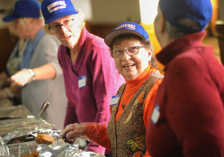 From left; Volunteers Karen Maloney, of Beacon Falls, Nancy Harkins, of Ansonia, and Marilyn Amaro, of Ansonia, serve the Master's Table Community Meals' Annual Thanksgiving Dinner at Assumption Church in Ansonia, Conn. on Sunday, November 19, 2017. The group serves meals at the church on the second and fourth Sundays of each month and will be holding their Annual Christmas Dinner on the second Sunday of December. Photo: Brian A. Pounds / Hearst Connecticut Media / Connecticut Post