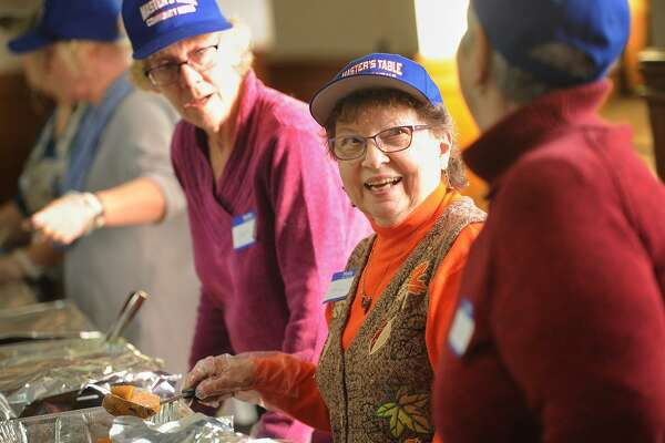 From left; Volunteers Karen Maloney, of Beacon Falls, Nancy Harkins, of Ansonia, and Marilyn Amaro, of Ansonia, serve the Master's Table Community Meals' Annual Thanksgiving Dinner at Assumption Church in Ansonia, Conn. on Sunday, November 19, 2017. The group serves meals at the church on the second and fourth Sundays of each month and will be holding their Annual Christmas Dinner on the second Sunday of December.