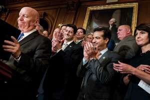 House Republicans celebrate passage of their tax bill on a 227-205 vote along party lines on Thursday.