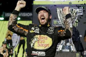 'Martin Truex Jr. caps career season with 1st NASCAR title - Photo' from the web at 'http://ww2.hdnux.com/photos/67/46/45/14575945/3/landscape_32.jpg'