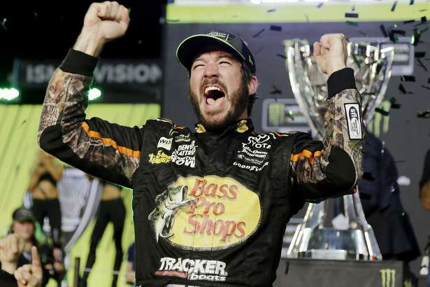 Martin Truex Jr. celebrates in Victory Lane after winning the NASCAR Cup Series auto race and season championship at Homestead-Miami Speedway in Homestead, Fla., Sunday, Nov. 19, 2017.  (AP Photo/Terry Renna)