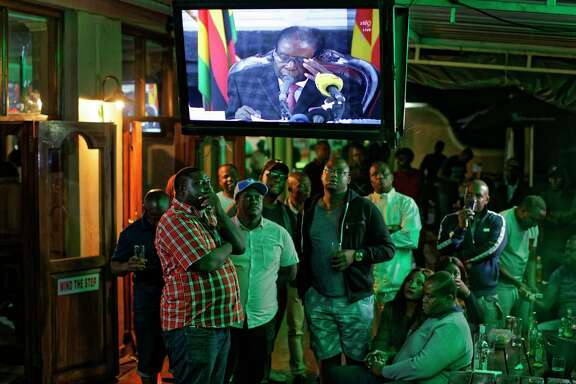 Disappointed Zimbabweans watch an address to the nation by President Robert Mugabe at a bar in Harare, the capital. Mugabe baffled the country by ending his address without announcing his resignation.
