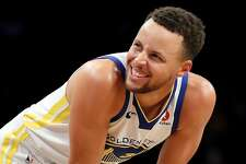 NEW YORK, NY - NOVEMBER 19: Stephen Curry #30 of the Golden State Warriors reacts in the second quarter against the Brooklyn Nets during their game at Barclays Center on November 19, 2017 in the Brooklyn borough of New York City. NOTE TO USER: User expressly acknowledges and agrees that, by downloading and or using this photograph, User is consenting to the terms and conditions of the Getty Images License Agreement.  (Photo by Abbie Parr/Getty Images)