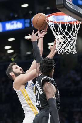 Golden State Warriors forward Omri Casspi (18), left, goes to the basket against Brooklyn Nets forward Rondae Hollis-Jefferson during the first half of an NBA basketball game, Sunday, Nov. 19, 2017, in New York. (AP Photo/Mary Altaffer)