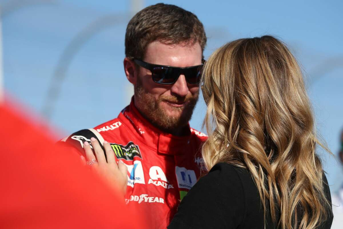 HOMESTEAD, FL - NOVEMBER 19: Dale Earnhardt Jr., driver of the #88 AXALTA Chevrolet, and his wife Amy during pre-race ceremonies for the Monster Energy NASCAR Cup Series Championship Ford EcoBoost 400 at Homestead-Miami Speedway on November 19, 2017 in Homestead, Florida. (Photo by Chris Graythen/Getty Images)