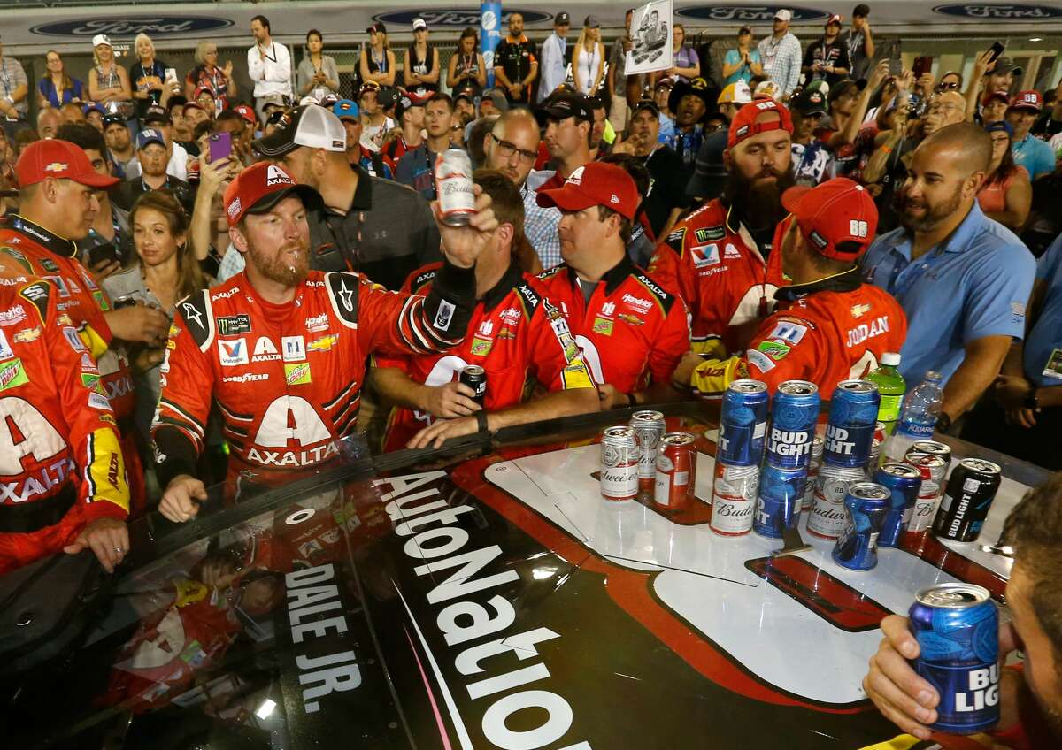 HOMESTEAD, FL - NOVEMBER 19: Dale Earnhardt Jr., driver of the #88 AXALTA Chevrolet, celebrates with teammates after his final cup series race, the Monster Energy NASCAR Cup Series Championship Ford EcoBoost 400 at Homestead-Miami Speedway on November 19, 2017 in Homestead, Florida. (Photo by Jonathan Ferrey/Getty Images)
