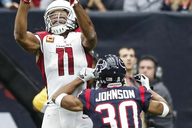 Arizona Cardinals wide receiver Larry Fitzgerald (11) goes up over Houston Texans cornerback Kevin Johnson (30) and pulls down a 20-yartd touchdown reception during the second quarter of an NFL football game at NRG Stadium on Sunday, Nov. 19, 2017, in Houston. ( Brett Coomer / Houston Chronicle )