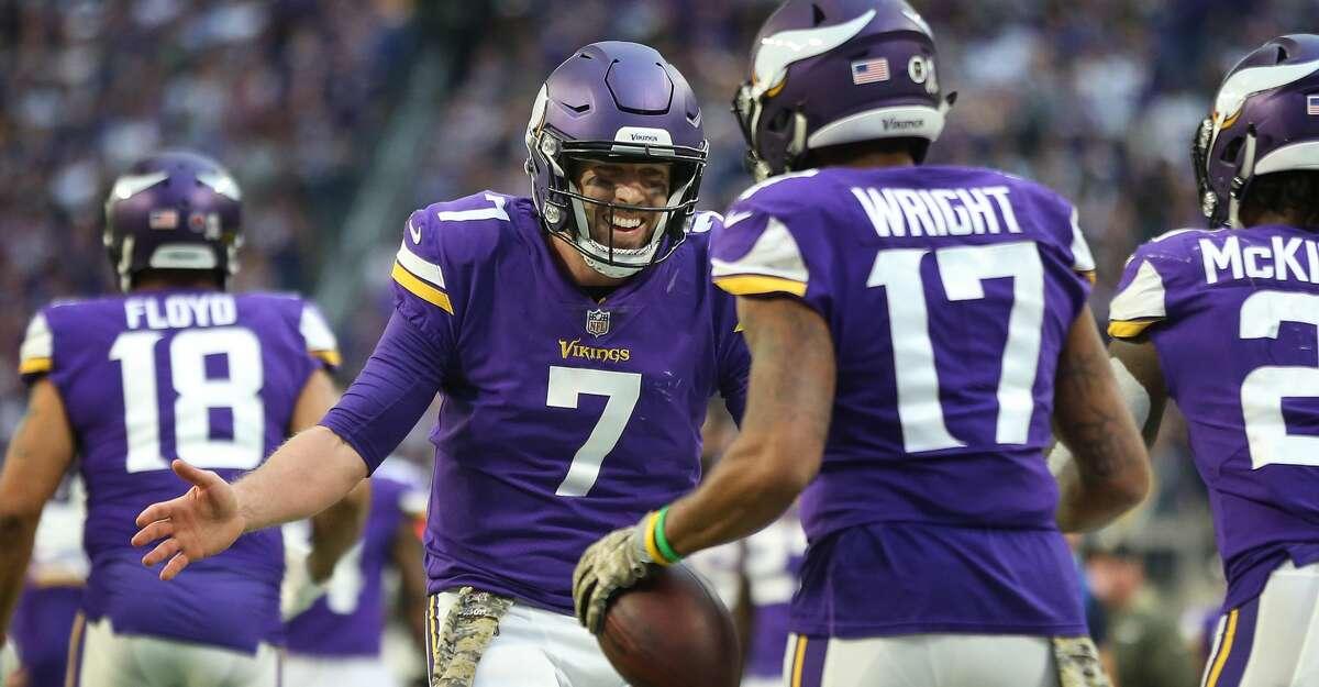 Minnesota Vikings quarterback Case Keenum (7) celebrates Adam Thielen's touchdown with receiver Jarius Wright (17) against the Los Angeles Rams on Sunday, Nov. 19, 2017 at U.S. Bank Stadium in Minneapolis, Minn. (Jerry Holt/Minneapolis Star Tribune/TNS)