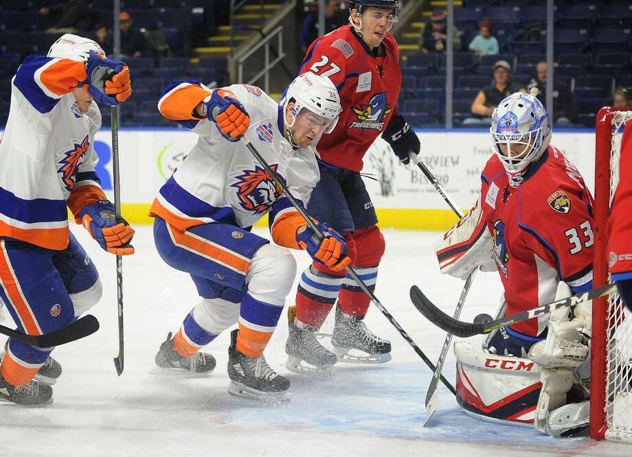 Bridgeport Sound Tiger Ross Johnston battles for a loose puck in front of Springfield Thunderbirds goalie Samuel Montembeault in the first period of their AHL hockey game at the Webster Bank Arena in Bridgeport, Conn. on Sunday, November 19, 2017. Photo: Brian A. Pounds / Hearst Connecticut Media / Connecticut Post