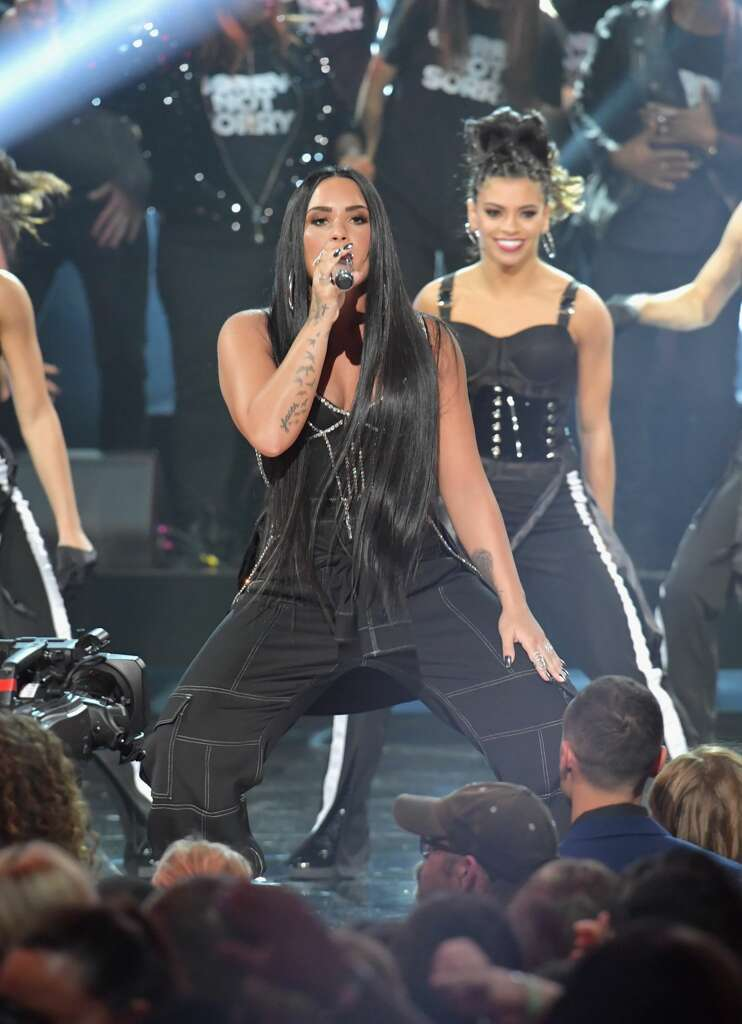 Texas women demi lovato selena gomez represented well during the los angeles ca november 19 demi lovato performs onstage during the 2017 american voltagebd Gallery