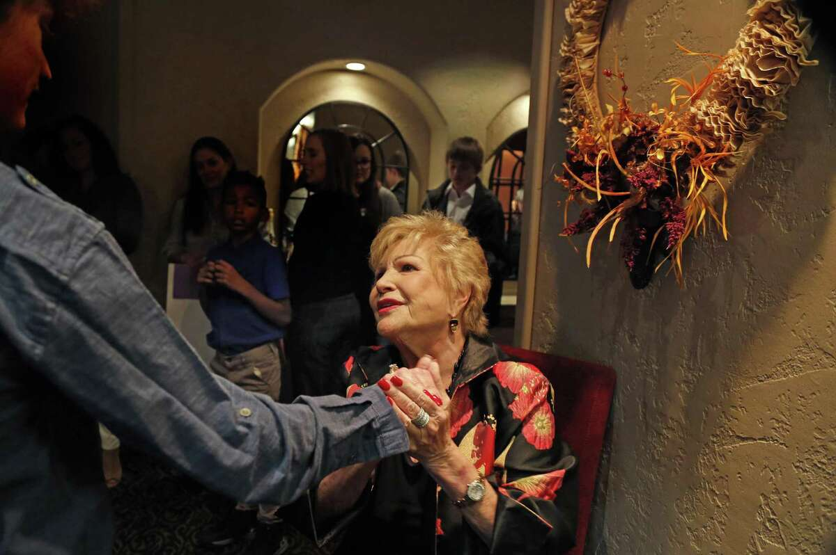 Lana Duke greets guest and has her picture taken with them as they arrived for the meal. Lana Duke, a former foster child and the owner of the Ruth's Chris steakhouses in San Antonio, is serving a Thanksgiving meal to more than 100 foster children from the Roy Maas youth shelter Sunday on Sunday, November 19, 2017.