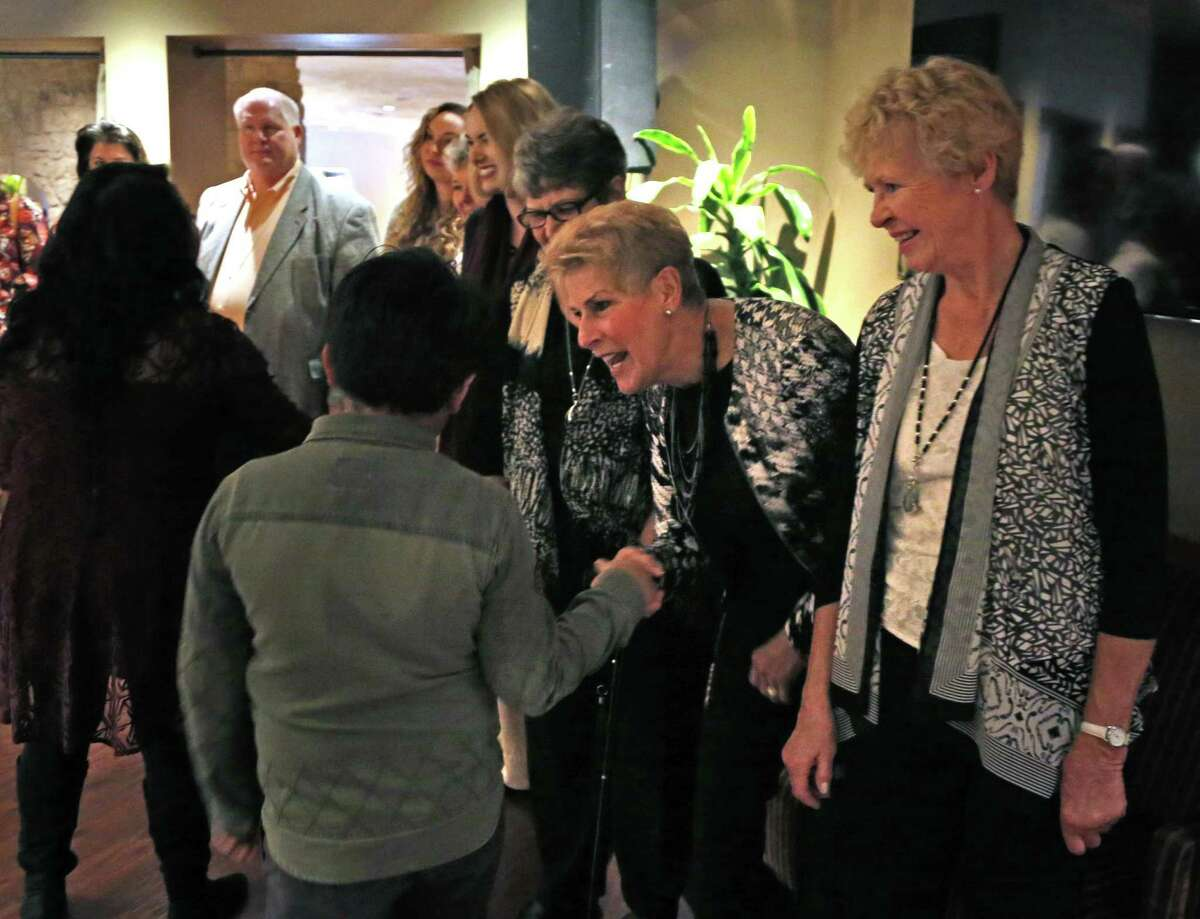 Jenny Kletke,greets a guest as Sheila Rienzo looks on. Ms Kletke and Rienzo are from Canada and were invited guest of Ms. Duke. Lana Duke, a former foster child and the owner of the Ruth's Chris steakhouses in San Antonio, is serving a Thanksgiving meal to more than 100 foster children from the Roy Maas youth shelter Sunday on Sunday, November 19, 2017.