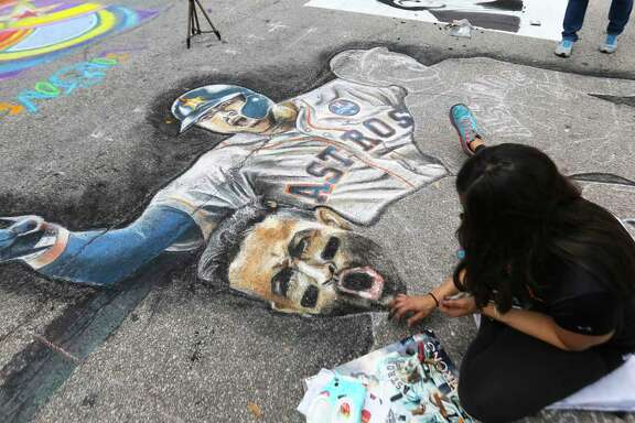Artist Brenda Melgar, of Alvin, works on her Houston Astros Worls Series chalk drawing at the 12th Annual Via Colori at Hermann Square at City Hall on Saturday, Nov. 18, 2017, in Houston. ( Yi-Chin Lee / Houston Chronicle )