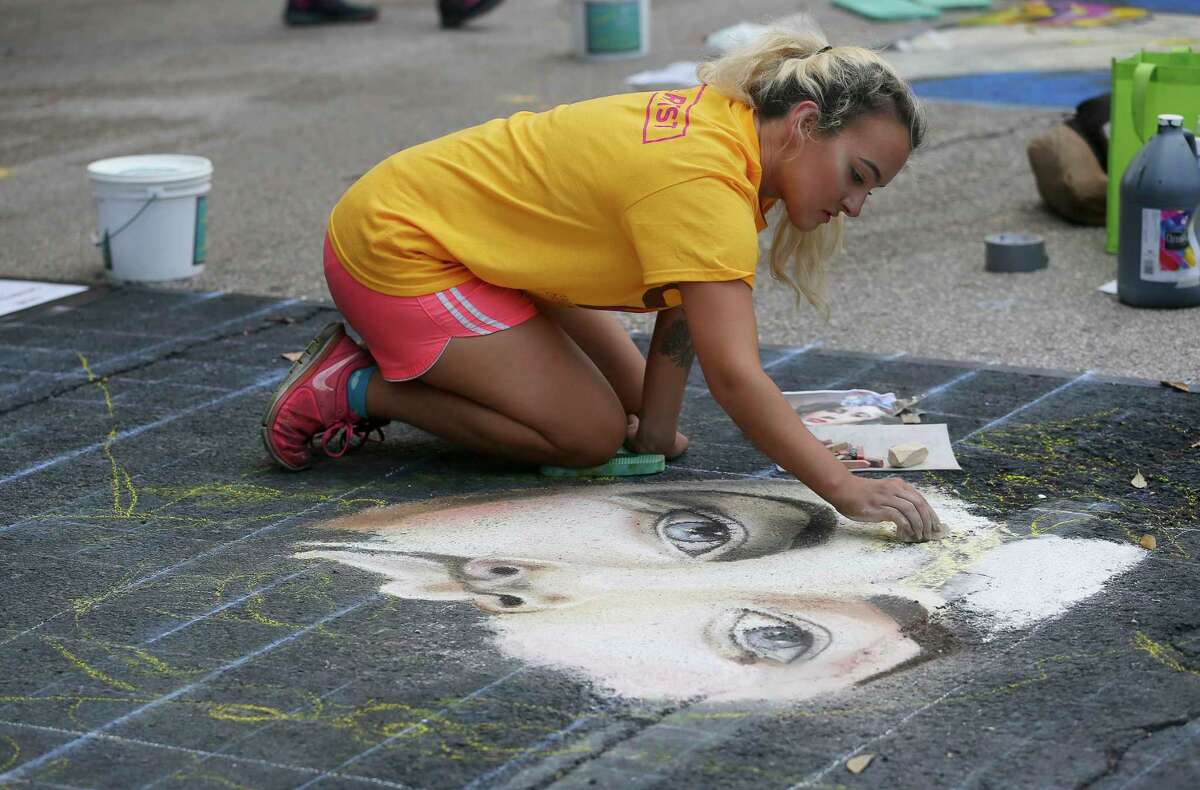 Artist Cathy Bozone, of Atlanta, G.A., works on her chalk drawing of actress Elizabeth Taylor in a collage at the 12th Annual Via Colori at Hermann Square at City Hall on Saturday, Nov. 18, 2017, in Houston. ( Yi-Chin Lee / Houston Chronicle )