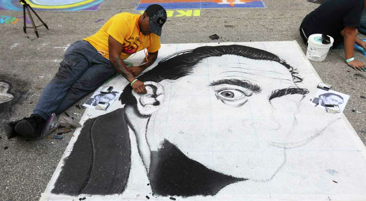 Houston artist Dezmon Williams works on his chalk drawing of Spanish artist Salvador Dali at the 12th Annual Via Colori at Hermann Square at City Hall on Saturday, Nov. 18, 2017, in Houston. ( Yi-Chin Lee / Houston Chronicle )