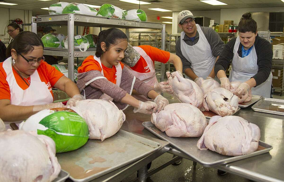 Volunteers cleaning turkeys at the convention center, Sunday, Nov. 19, 2017, in preparation for the Raul Jimenez Thanksgiving Dinner. Over 550 turkeys will be served at the annual event on Thursday.