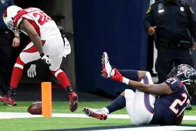 Texans running back D'Onta Foreman raced to a 34-yard touchdown in the fourth quarter, rupturing his Achilles tendon in the process.