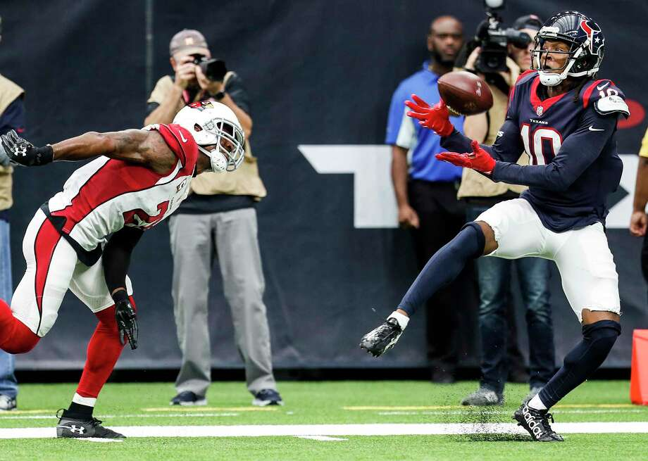 Wide receiver DeAndre Hopkins, right, was able to get the better of his matchup with Cardinals cornerback Patrick Peterson on Sunday, catching four passes for 76 yards and one touchdown. Photo: Brett Coomer, Staff / © 2017 Houston Chronicle