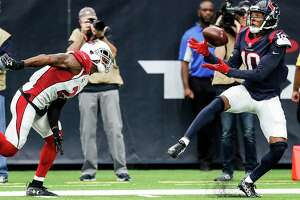 Wide receiver DeAndre Hopkins, right, was able to get the better of his matchup with Cardinals cornerback Patrick Peterson on Sunday, catching four passes for 76 yards and one touchdown.