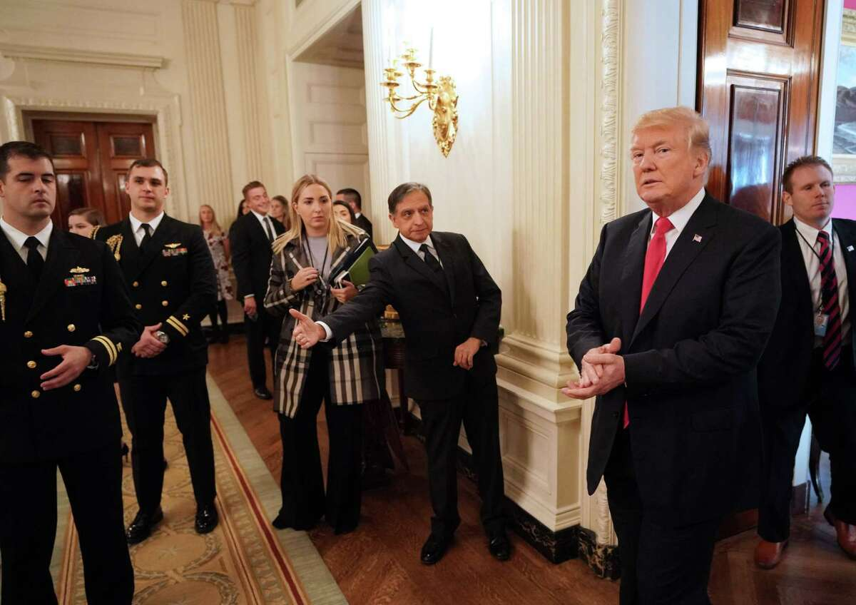 President Donald Trump arrives in the State Dining Room during an event honoring the NCAA national championship teams on Nov. 17, 2017. (AFP/Getty Images)