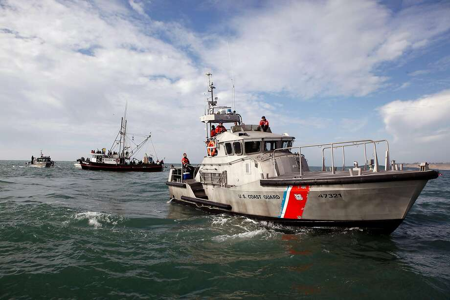 The Coast Guard said a body had been found in the water and a search has been launched for a second person believed to be aboard the boat. Photo: Michael Short, The Chronicle