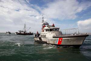 The flotilla of boats was closely policed by the Coast Guard during the 2014 Maverick's Invitational surf contest held in Half Moon Bay, CA, Friday, January 24, 2014.