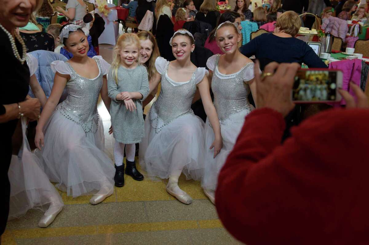 Jacksyn Brockway, 4, of Greenwich, and her grandmother, Paula Woodard also of Greenwich, pose for a photo with dancers from Northeast Ballet Company at the 2017 Nutcracker Tea at SPAC on Sunday, Nov. 19, 2017, in Saratoga Springs, N.Y. (Paul Buckowski / Times Union)