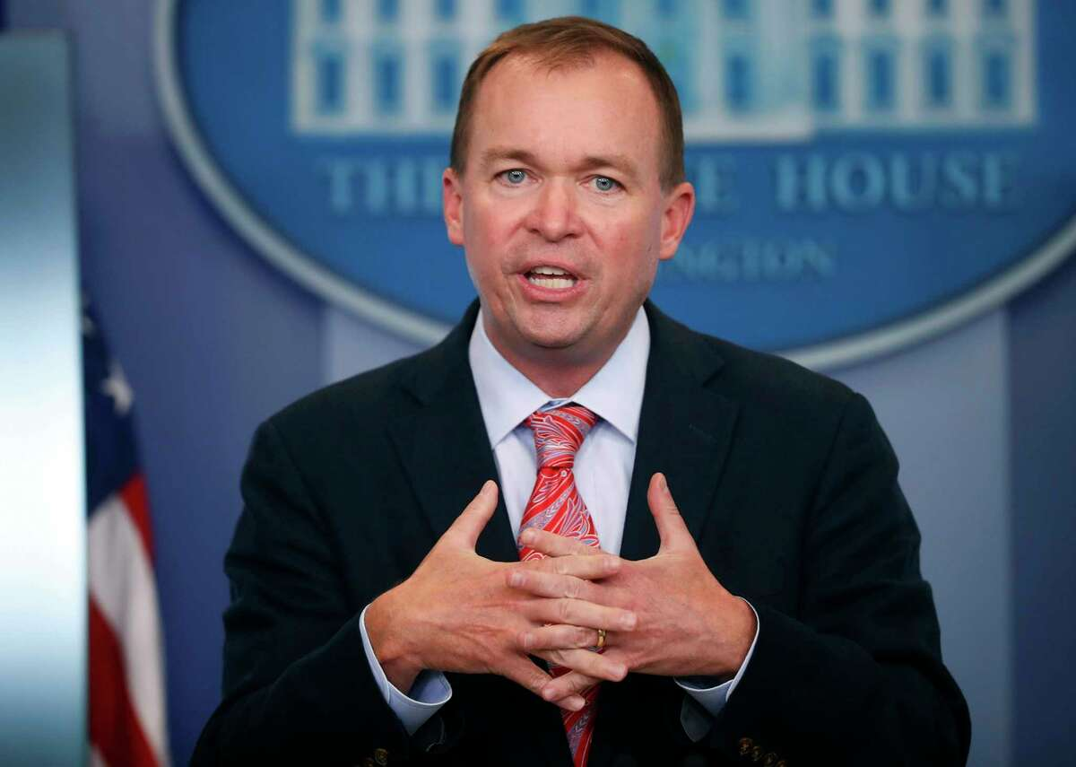 FILE - In this Thursday, July 20, 2017, file photo, Budget Director Mick Mulvaney gestures as he speaks during the daily press briefing at the White House in Washington. Mulvaney and Treasury Secretary Steven Mnuchin sent mixed signals Sunday, Nov. 19, on the fate of a health care provision in the Senate version of a $1.5 trillion measure to overhaul business and personal income taxes that is expected to be voted on after Thanksgiving.