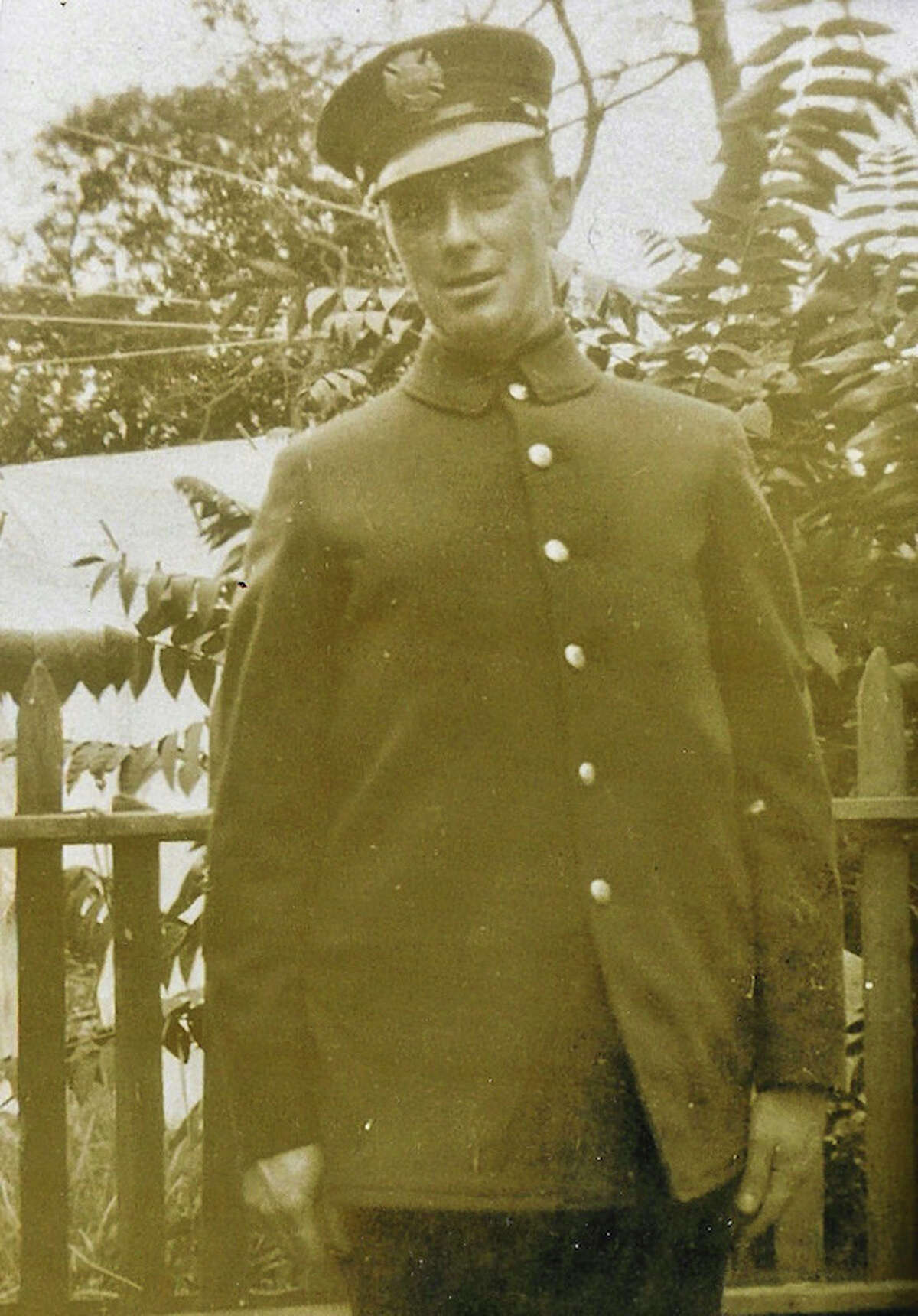 This undated photo provided by Arthur O'Brien shows his grandfather Thomas O'Brien in his fireman's uniform after he joined the FDNY in 1917. O'Brien's heirs say their grandfather was found dead in his firehouse bunk hours after suffering a six-inch skull fracture at a Manhattan fire in 1935 and should be honored as a