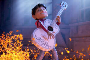 """Miguel (voiced by Anthony Gonzalez) has a dream to make music, in Pixar's new """"Coco."""" MUST CREDIT: Disney-Pixar"""