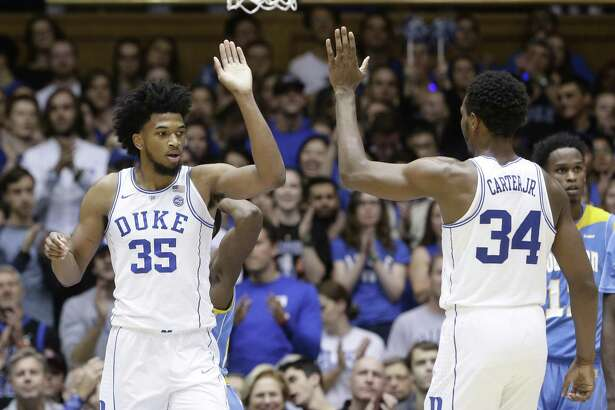 Duke's Marvin Bagley III, left, and Wendell Carter Jr. react following a play against Southern on Friday.