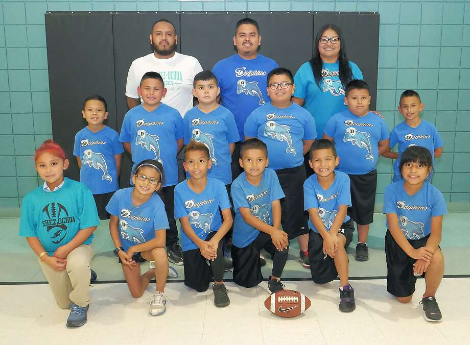After witnessing a fatal shooting at practice, the Sanchez-Ochoa Elementary team went 3-0 in the playoffs to capture the city championship in the Boys & Girls Clubs of Laredo flag football league. Pictured kneeling from left are Solange Rios, Mia Camacho, Jose Elias, Rey Mata, Daveron Ramos and Makayla Salinas. In the second row are Marion Moreno, Rodrigo Marquez, Brandon Esparza, Gerrardo Riojas Jr., Pedro Medina and Bryan Marquez, and the coaches are Jose Elias, Roy Mata and Brandy Ordóñez. Photo: Cuate Santos / Laredo Morning Times / Laredo Morning Times