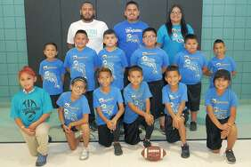 After witnessing a fatal shooting at practice, the Sanchez-Ochoa Elementary team went 3-0 in the playoffs to capture the city championship in the Boys & Girls Clubs of Laredo flag football league. Pictured kneeling from left are Solange Rios, Mia Camacho, Jose Elias, Rey Mata, Daveron Ramos and Makayla Salinas. In the second row are Marion Moreno, Rodrigo Marquez, Brandon Esparza, Gerrardo Riojas Jr., Pedro Medina and Bryan Marquez, and the coaches are Jose Elias, Roy Mata and Brandy Ordóñez.