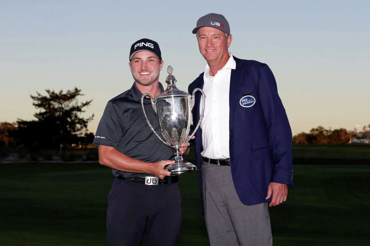 ST SIMONS ISLAND, GEORGIA - NOVEMBER 19: Austin Cook of United States and Davis Love III of the United States poses with the trophy on the 18th green after winning the final round of The RSM Classic at Sea Island Golf Club Seaside Course on November 19, 2017 in St Simons Island, Georgia. (Photo by Streeter Lecka/Getty Images) ORG XMIT: 775055556