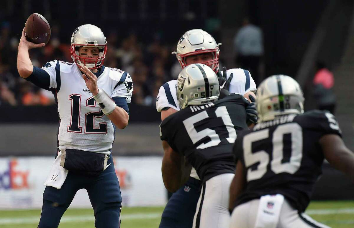 New England Patriots' Tom Brady throws the ball during the 2016 NFL week 11 regular season football game against Oakland Raiders on November 19, 2017 at the Azteca Stadium in Mexico City. / AFP PHOTO / ALFREDO ESTRELLAALFREDO ESTRELLA/AFP/Getty Images