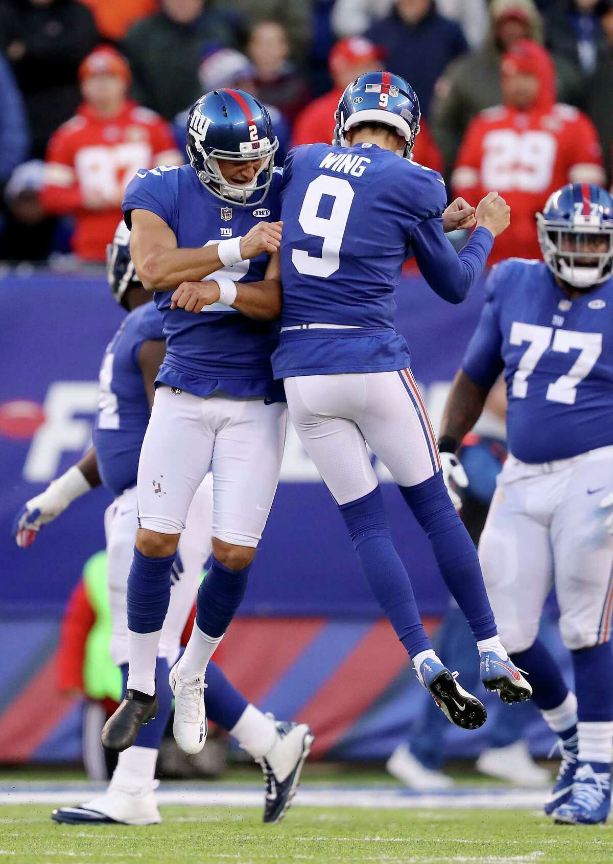 EAST RUTHERFORD, NJ - NOVEMBER 19: Aldrick Rosas #2 of the New York Giants celebrates his field goal with teammate Brad Wing #9 in the fourth quarter against the Kansas City Chiefs on November 19, 2017 at MetLife Stadium in East Rutherford, New Jersey. (Photo by Elsa/Getty Images) ORG XMIT: 700070748