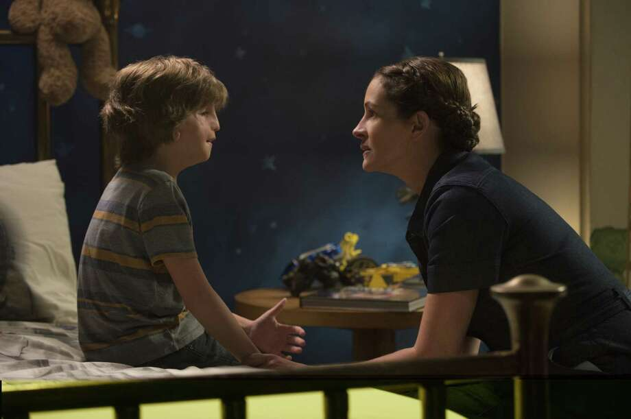 "This image released by Lionsgate shows Jacob Tremblay, left, and Julia Roberts in a scene from ""Wonder."" (Dale Robinette/Lionsgate via AP) ORG XMIT: NYET935 Photo: Dale Robinette / Lionsgate"