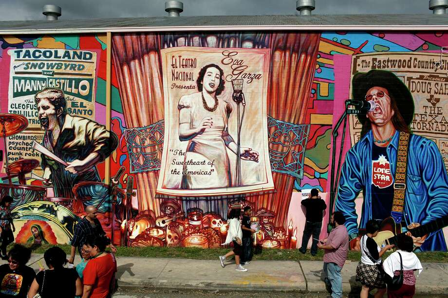 """The mural """"La Musica De San Anto"""" honors area musicians who have passed, including Manny Castillo who started the mural before his death. This photo was taken during the community blessing for the mural on the side of the A-Amigo Bail Bonds building facing Commerce Street Nov. 21, 2009. Photo: Lisa Krantz / San Antonio Express-News / SAN ANTONIO EXPRESS-NEWS"""