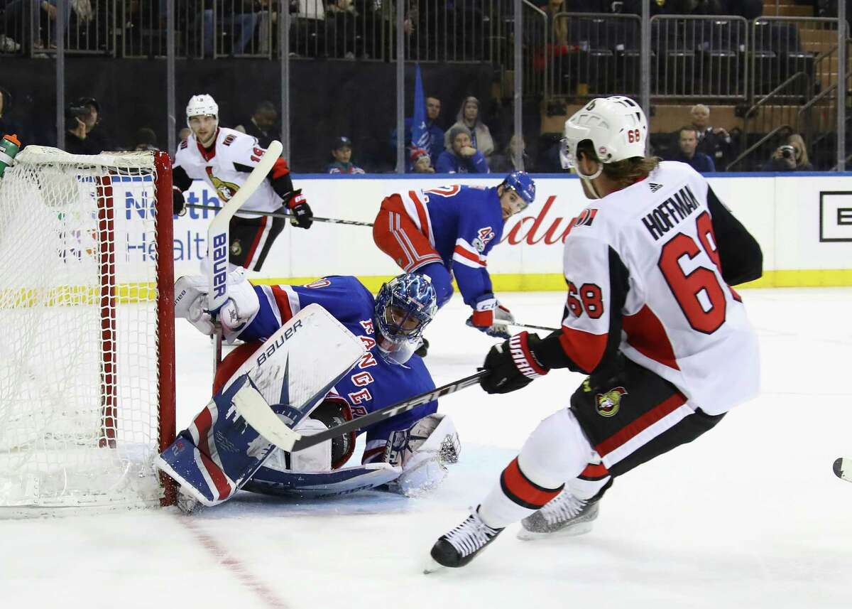 NEW YORK, NY - NOVEMBER 19: Henrik Lundqvist #30 of the New York Rangers makes the first period save on Ryan Dzingel #18 of the Ottawa Senators at Madison Square Garden on November 19, 2017 in New York City. (Photo by Bruce Bennett/Getty Images) ORG XMIT: 775040858