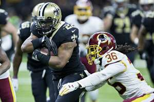 NEW ORLEANS, LA - NOVEMBER 19:  Mark Ingram II #22 of the New Orleans Saints runs the ball and is tackled by D.J. Swearinger #36 of the Washington Redskins at Mercedes-Benz Superdome on November 19, 2017 in New Orleans, Louisiana.  Saints defeated the Redskins 34-31.  (Photo by Wesley Hitt/Getty Images) ORG XMIT: 700070750