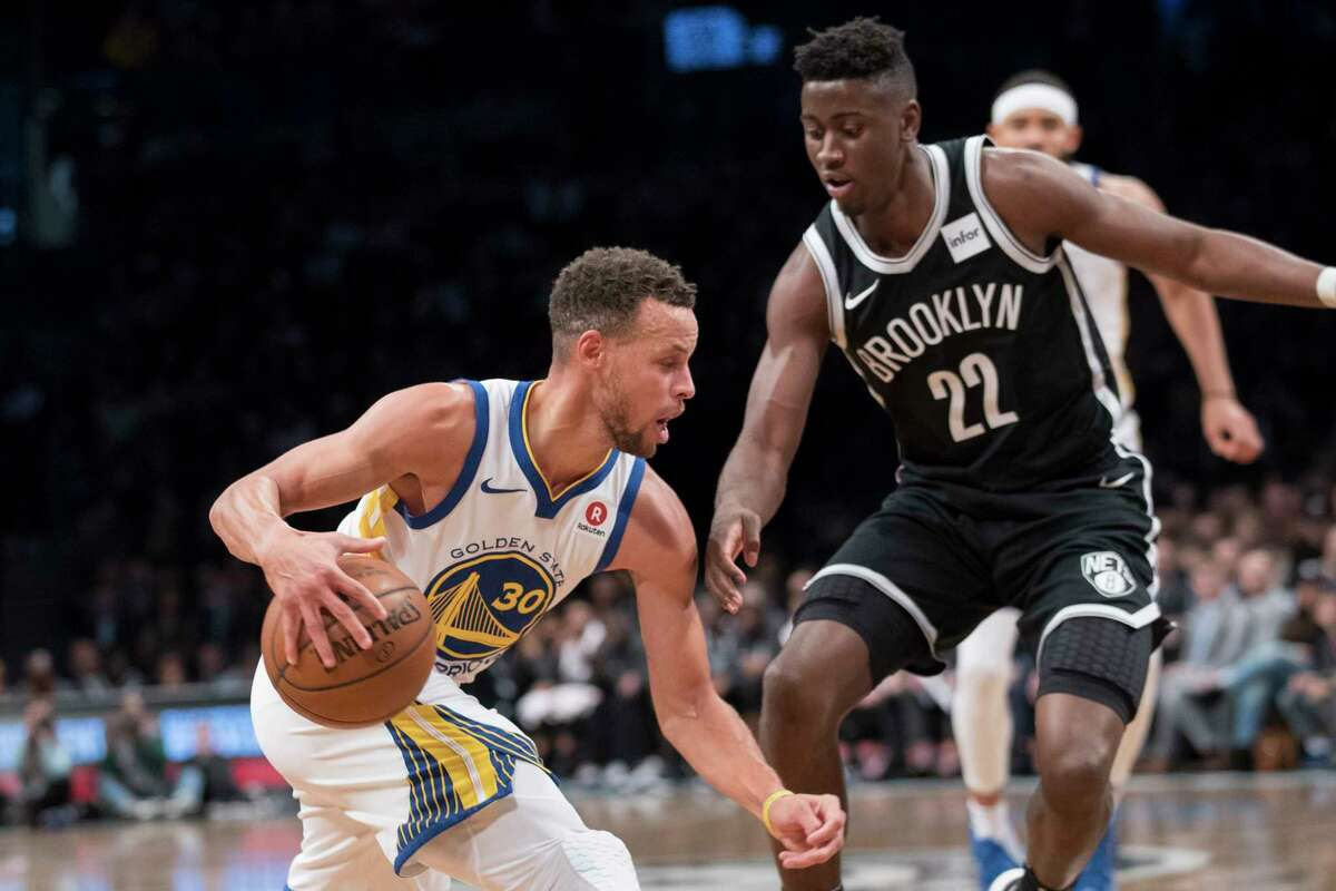 Golden State Warriors guard Stephen Curry (30) drives to the basket against Brooklyn Nets guard Caris LeVert (22) during the first half of an NBA basketball game, Sunday, Nov. 19, 2017, in New York. (AP Photo/Mary Altaffer) ORG XMIT: NYMA101