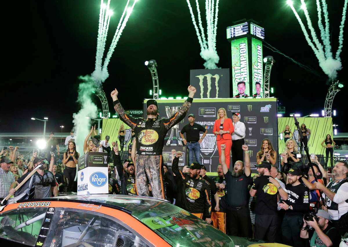 Martin Truex Jr. celebrates in Victory Lane after winning the NASCAR Cup Series auto race and season championship at Homestead-Miami Speedway in Homestead, Fla., Sunday, Nov. 19, 2017. (AP Photo/Terry Renna) ORG XMIT: FLTR107