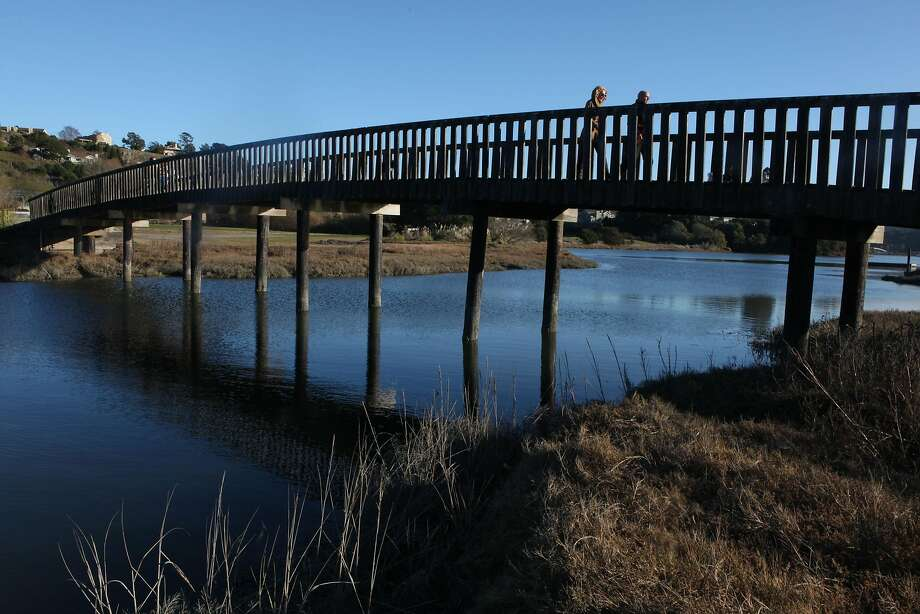 A pedestrian bridge is crossed by hikers at the Mill Valley-Sausalito Path in Mill Valley.  Photo: Liz Hafalia, The Chronicle